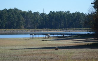 An old pier is now visible as water is drained from the Lake Hico area.