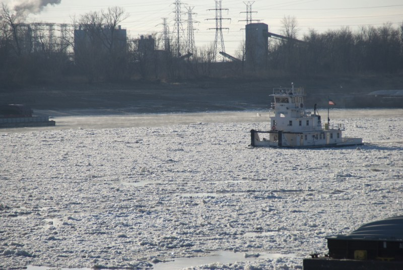 A tow pushes through ice on the Mississippi River at downtown St. Louis