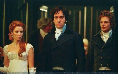 Kelly Reilly as Caroline Bingley, Matthew Macfadyen as Mr. Darcy and Simon Woods as Mr. Bingley