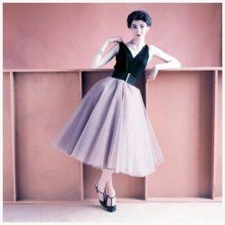 Model in sleeveless black jersey evening blouse and tulle dancing skirt above taffeta underskirt, 1952