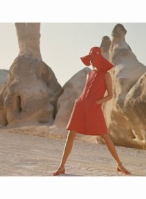 Model in G�reme, Turkey, wearing sleeveless red button-front linen dress by Kasper for Joan Leslie. *** Local Caption ***