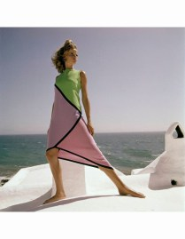 At the ocean side, the model, Veruschka, wearing an asymmetrical cotton jersey dress in geometric shapes of green, lavender, pink and black *** Local Caption *** Veruschka;