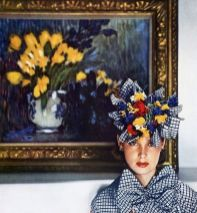 checked-silk-taffeta-gilet-and-hat-with-flowers-by-john-frederics-photo-by-hoyningen-huene-in-front-of-floral-still-life-by-picasso-at-jacques-seligman-gallery-harpers-bazaar-june-1940