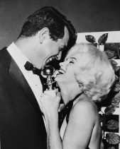 13th March 1962: Marilyn Monroe (Norma Jean Mortenson or Norma Jean Baker, 1926 - 1962) receives her Golden Globe award from Rock Hudson (1925 - 1985) at the Hollywood Foreign Press Association's 19th Annual Dinner. (Photo by Keystone/Getty Images)