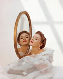 Woman Gazing in Oval Mirror for Glamour, 1949