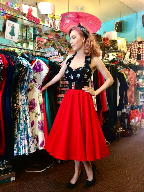Black halter top, belt and bandana paired with red circle skirt and petticoat