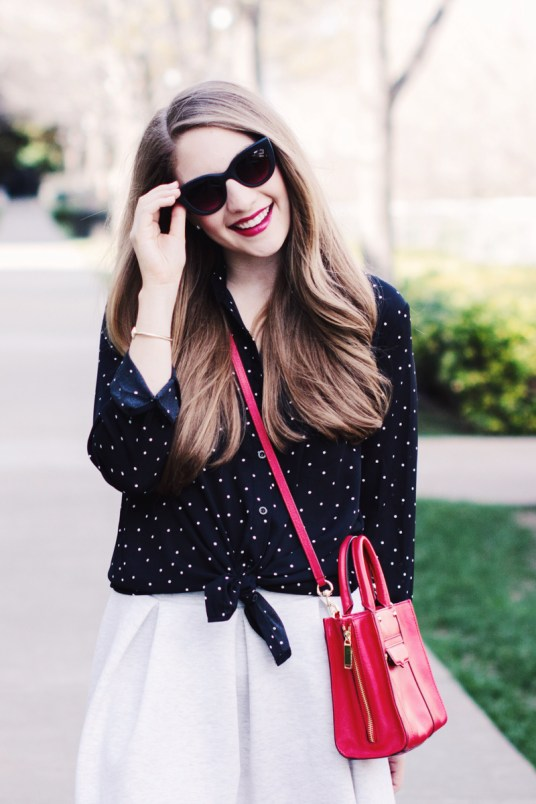Polka dot tie front blouse and red crossbody