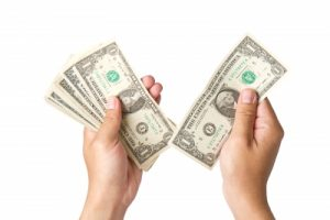two hands holding one dollar bills on white background