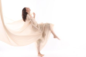 woman dancing with sheet