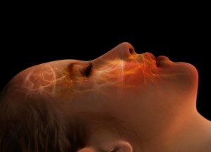 Woman sleeping with energy waves flowing over her face