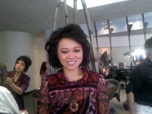 Claudia Chan smiling backstage