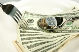 Eating money, money, cash, change, dollar bills, fork, spoon