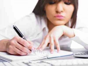 woman writing, freelance writing
