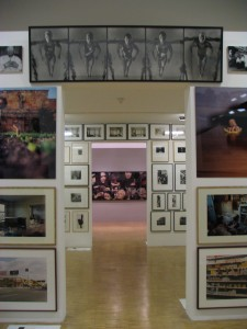 A hallway with photos of art