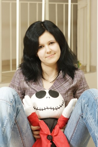 depressed girl holding stuffed toy