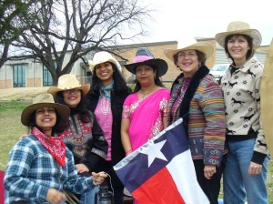 posiitive force, mina khan, a group of women in cowboy hats with texas flag