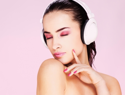 woman with white headphones on