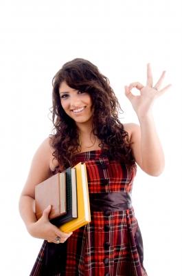 girl holding textbooks