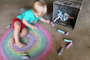 boy playing with chalk