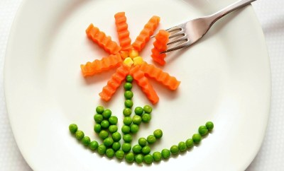 carrots and peas on a plate