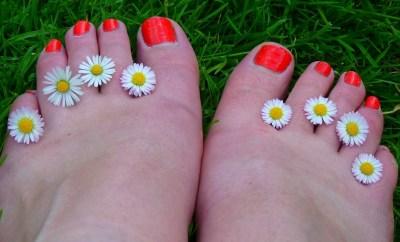 flowers between toes
