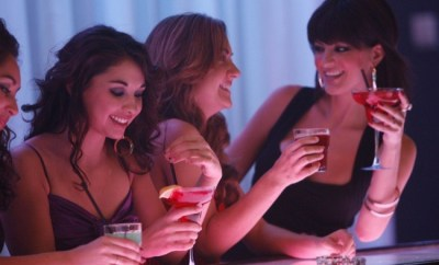 women enjoying drinks at a bar