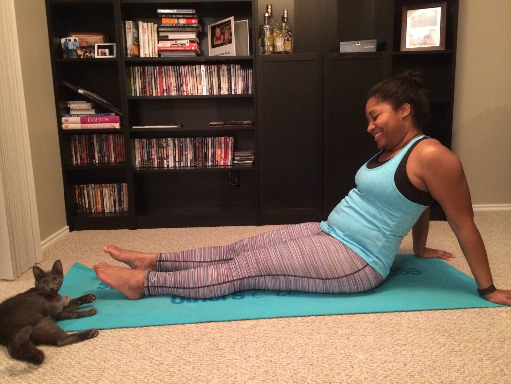 woman on yoga mat ready to workout in soffee clothes