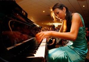Asian woman playing piano