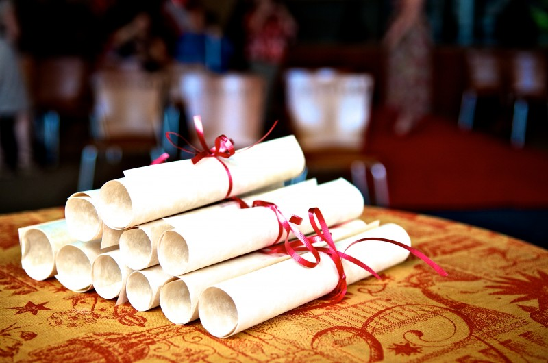 diplomas stacked on table