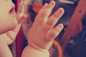 baby feet, wedding rings