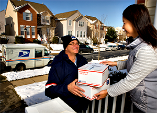usps man delivering a package for the holidays