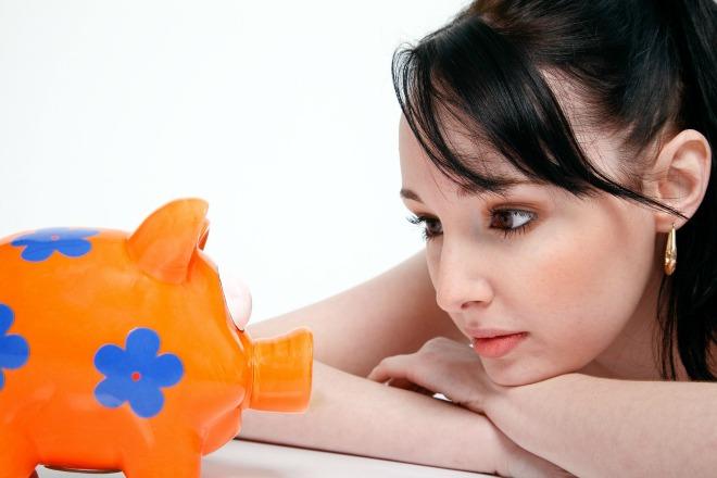 woman piggy bank 401k savings