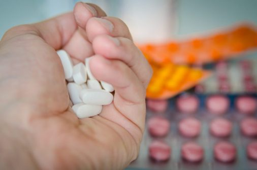 pills held by pharmacist who has careers that make you rich