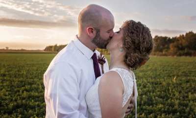bride and groom kissing after wedding prep