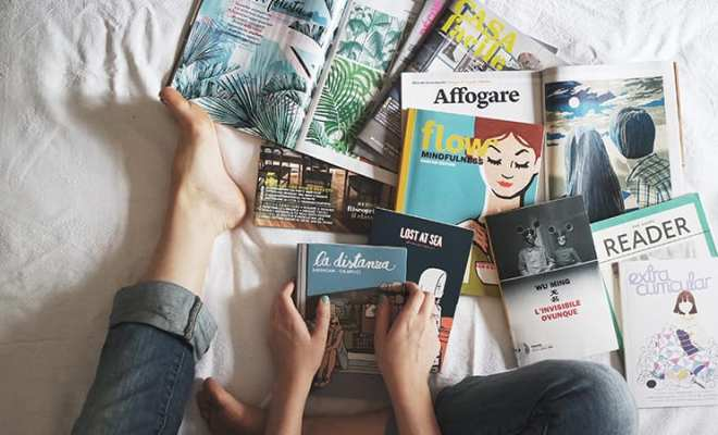 books spread out on bed are what you should be reading