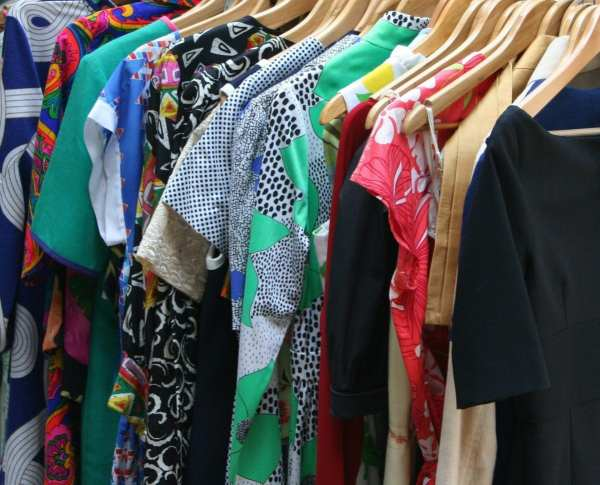 closeup of dresses on hangers