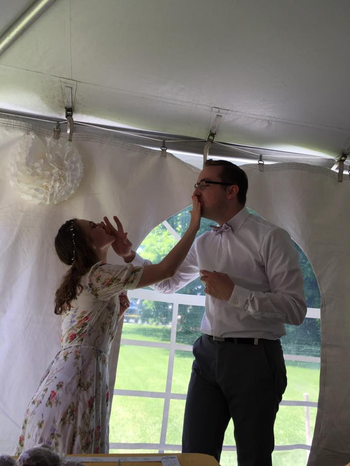 man and woman feeding each other at wedding