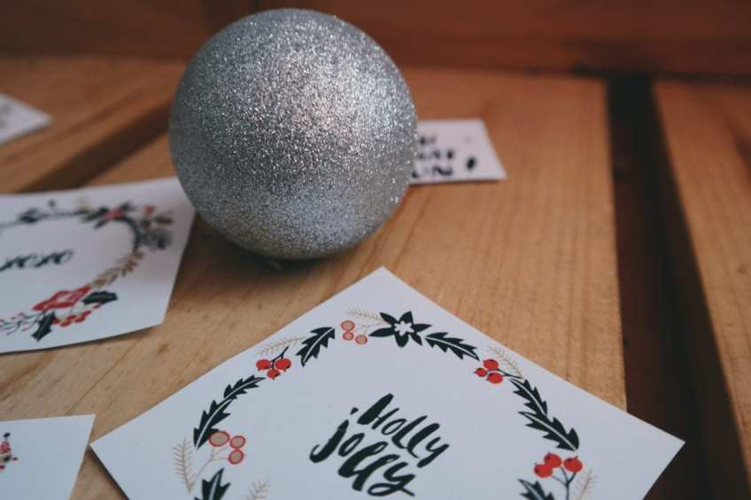 holiday cards and silver glitter ball