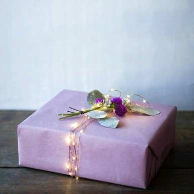 Purple paper gift wrapping idea