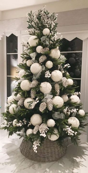 Christmas tree with bleached pine cones and oversize decoration globe