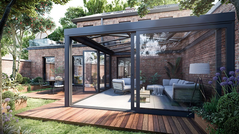 Contemporary patio decor with glass walls and wood floor