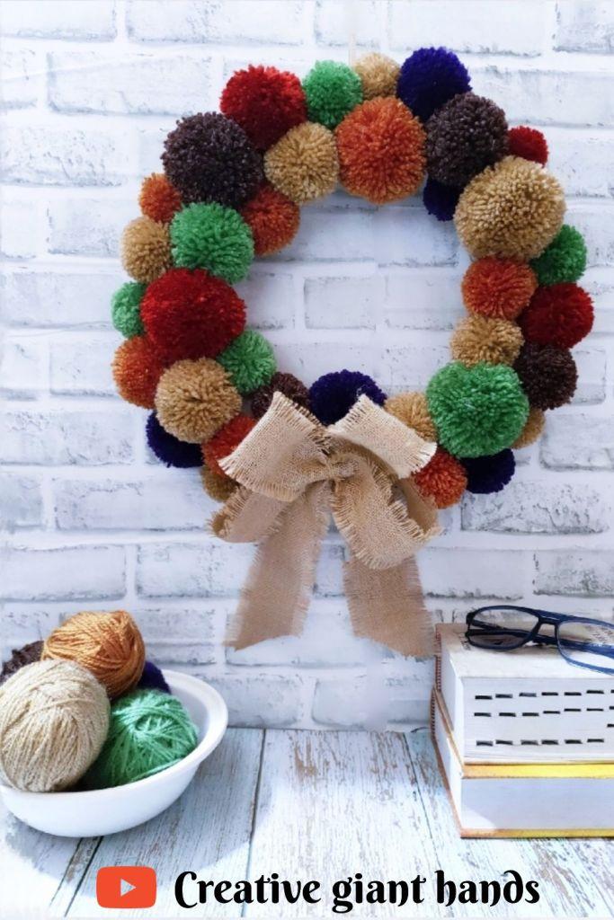 Creative giant hands pom pom wreath