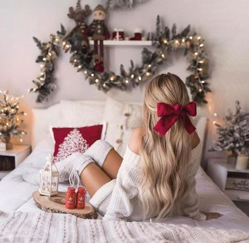 Easy Christmas hairstyle with a red bow