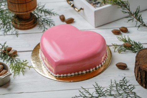 Elegant Pink heart cake decorated with fondant texture