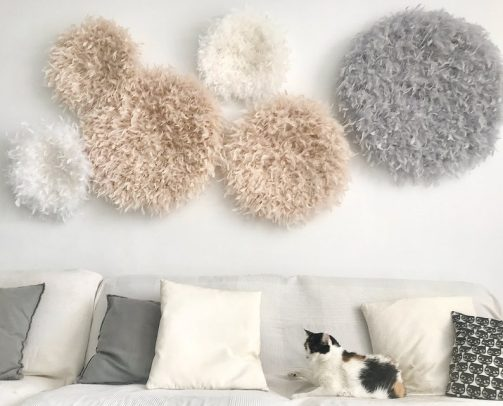Fluffy juju hat above the couch for creating a cozy decor