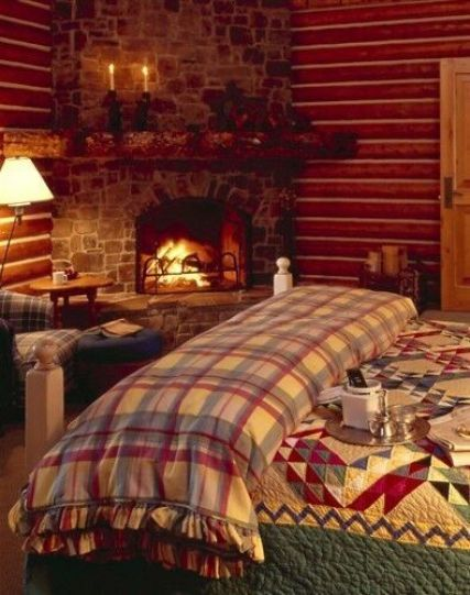 Log cabin with fireplace in the bedroom