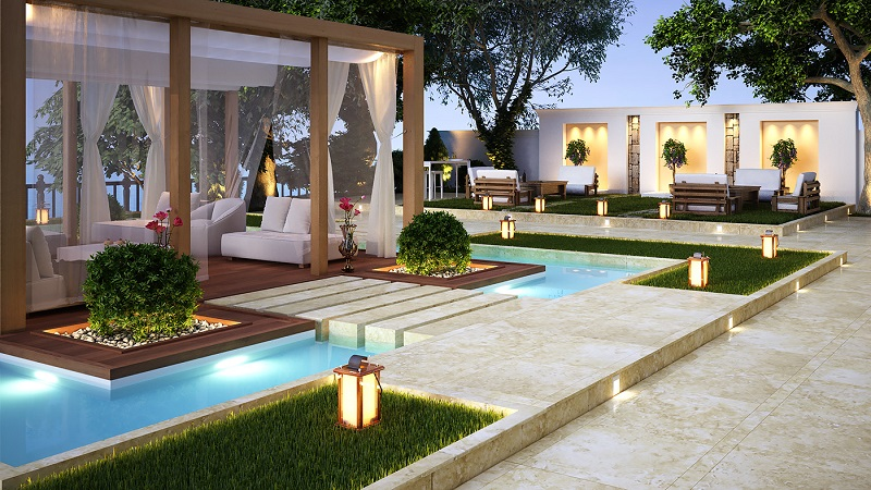 Luxury outdoor living space with pool and lights