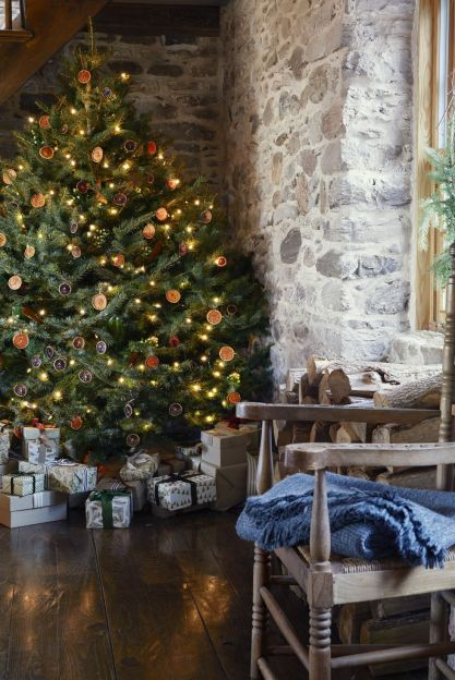 Rustic Christmas tree decorated with citrus garlands