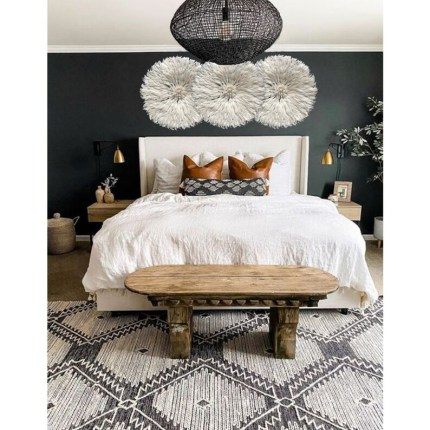 Rustic bedroom with juju hat wall hanging decorations