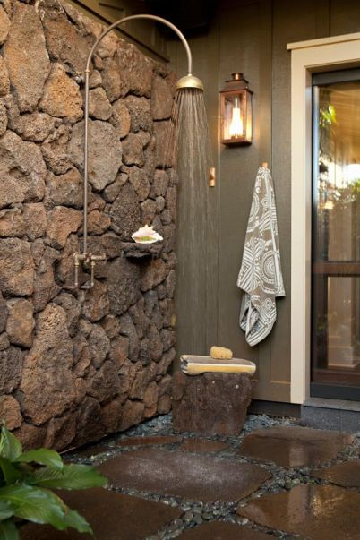 Rustic style bathroom with stone wall